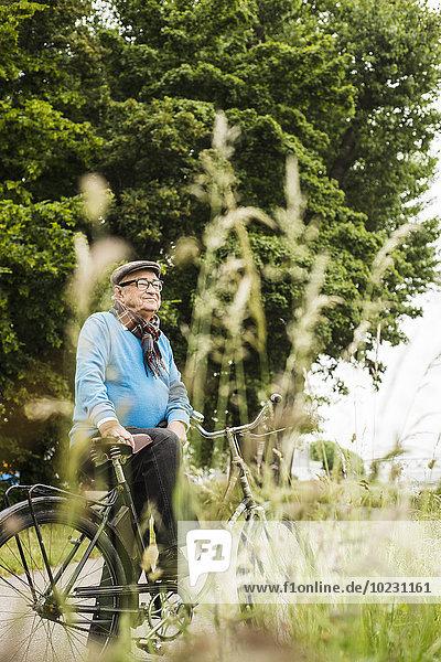 Happy senior man with bicycle