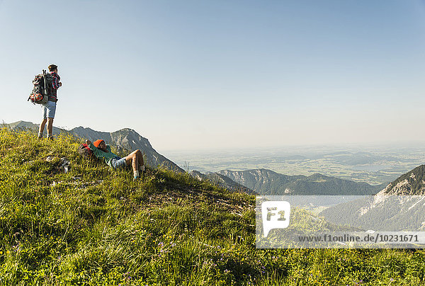 Austria  Tyrol  Tannheimer Tal  young couple resting on alpine meadow