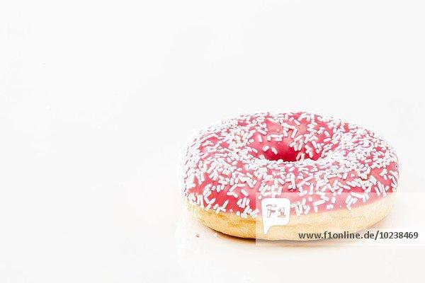 Pink Donut mit Zuckerstreuseln