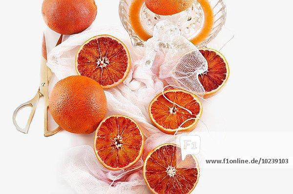 Blutorangen und Orangenpresse