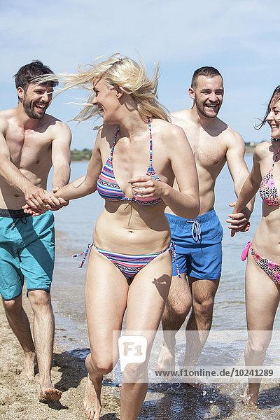 Group of friends on beach having fun