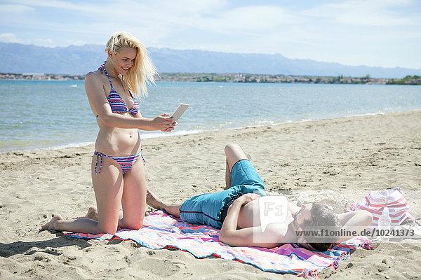 benutzen Strand jung Tablet PC