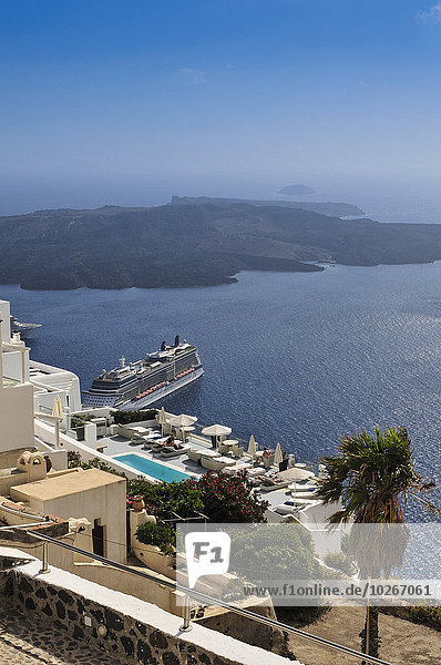 Ships in the harbour of Thera  with the Island of Nea Kameni in the background; Thera  Santorini  Greece