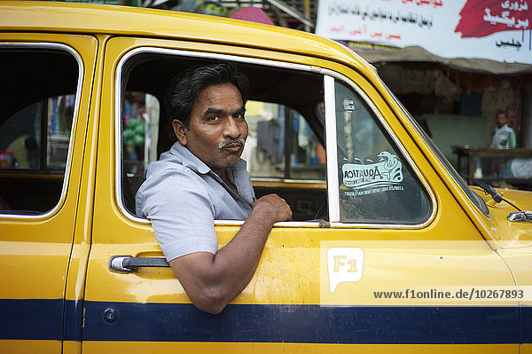 Taxi driver with mouthful of paan; Kolkata  West Bengal  India
