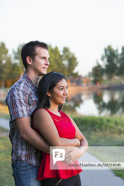 'Mixed race couple spending quality time together in a park in autumn; St. Albert  Alberta  Canada'