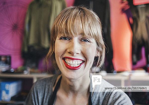 Portrait of happy female mechanic in workshop
