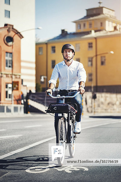Businessman commuting on bicycle in city