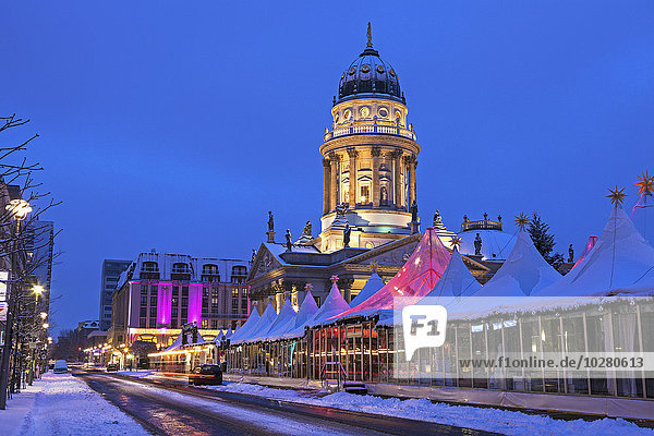 Christmas Market and illuminated steeple of French Cathedral