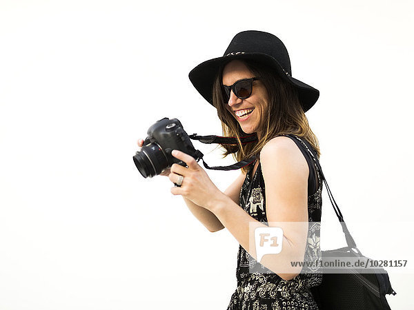 Woman taking photos during vacations