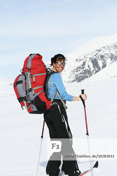 Frau lächeln Skisport