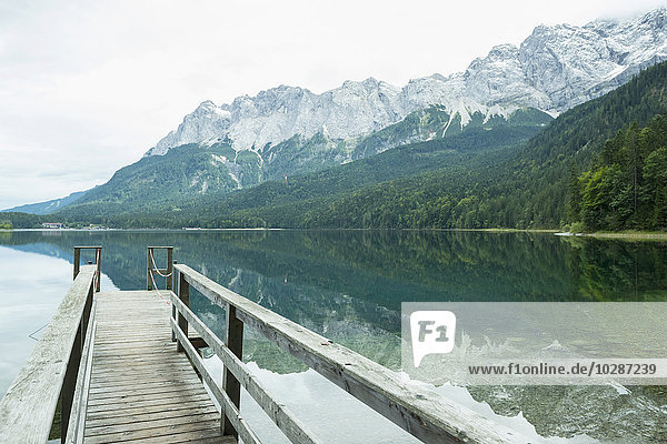 Zugspitze reflecting in Eibsee lake  Bavaria  Germany