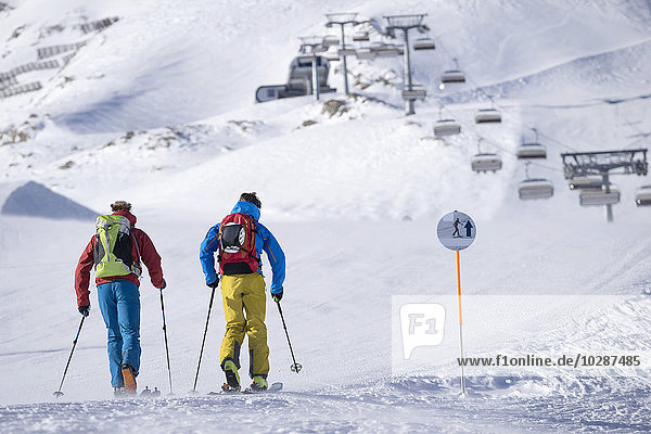 Tourists skiing on ski track  Zell Am See  Austria