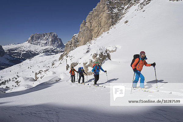Ski mountaineers climbing on snowy mountain  Val Gardena  Trentino-Alto Adige  Italy