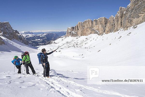 Ski mountaineers climbing on snowy mountain  Val Gardena  Trentino-Alto Adige  Italy Ski mountaineers climbing on snowy mountain, Val Gardena, Trentino-Alto Adige, Italy