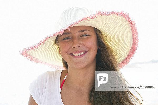Sweden  Stockholms Archipelago  Sodermanland  Portrait of smiling girl (12-13) in sunhat