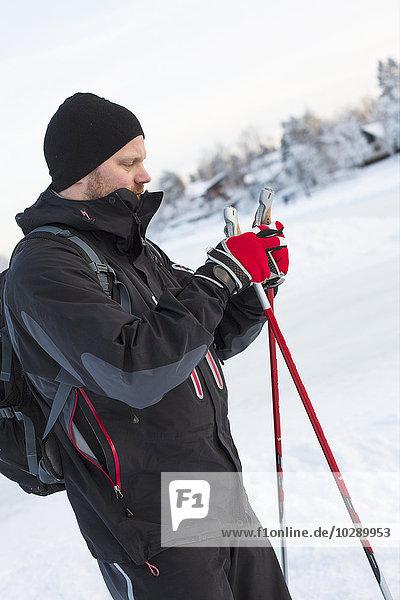 Sweden  Stockholm  Alvsjo  Man preparing for nordic walking