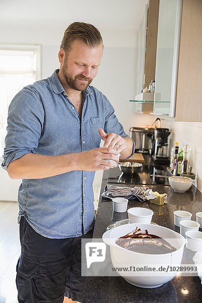 Sweden  Sodermanland  Alvsjo  Man preparing chocolate souffle