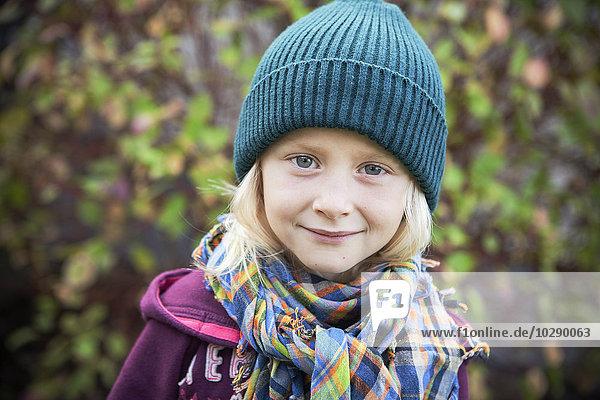 Sweden  Portrait of girl (6-7) in autumn