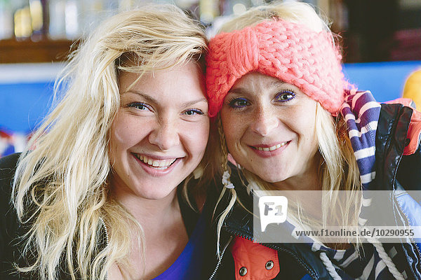 Greece  Dodecanese  Kalymnos  Portrait of two smiling blonde women
