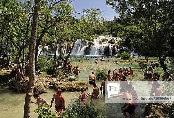 Croatia  Krka National Park  Skradinski buk  tourists bathing in pool at waterfall