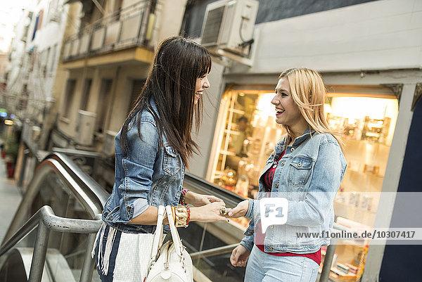 Spain  Jaen  two young women on shopping tour