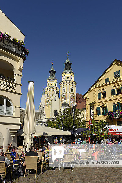 Italy  Alto Adige  Brixen  Street cafe on Cathedral square  Cathedral Mariae Himmelfahrt in the background