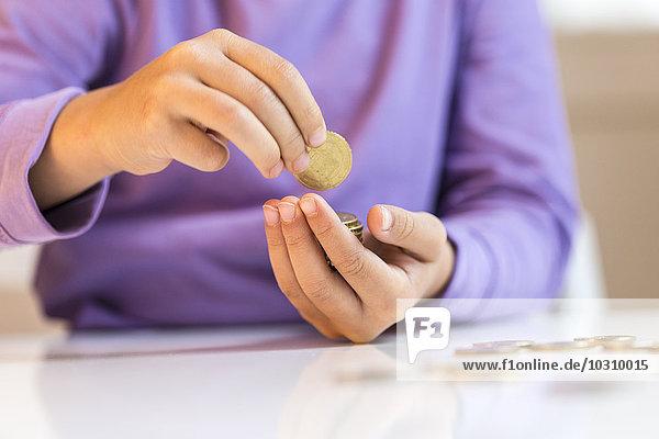 Little girl counting pocket money
