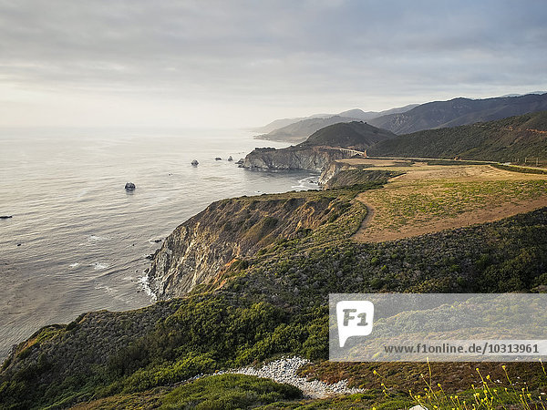 USA  California  Pacific Coast  National Scenic Byway  Big Sur  Coastline with Bixby Bridge at sunset