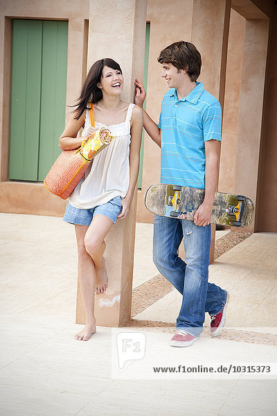 Portrait of smiling young couple communicating
