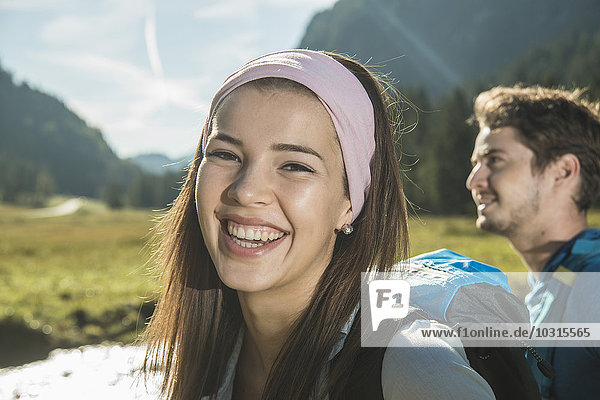 Austria  Tyrol  Tannheimer Tal  portrait of happy young woman wearing hair-band