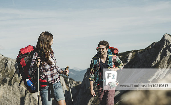 Austria  Tyrol  Tannheimer Tal  young couple hiking at rocks