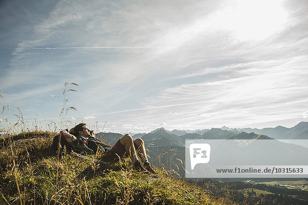 Austria  Tyrol  Tannheimer Tal  young hiker having a rest