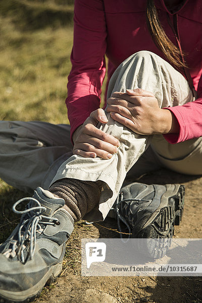 Austria,  Tyrol,  Tannheimer Tal,  injured young woman on hiking tour