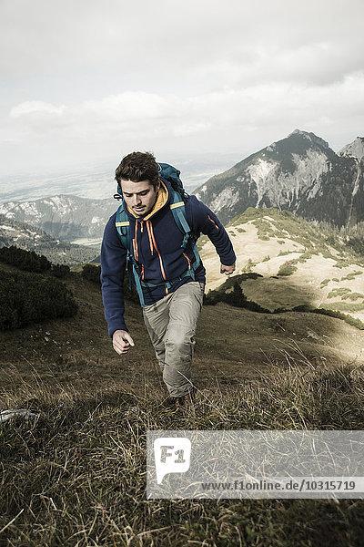 Austria  Tyrol  Tannheimer Tal  young man hiking