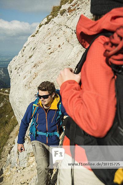 Austria  Tyrol  Tannheimer Tal  young couple hiking on rock