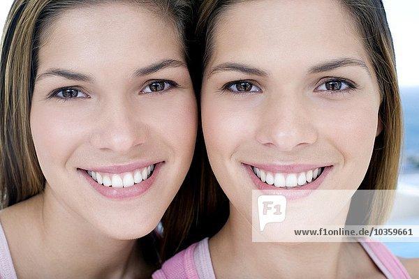 Teenage twin sisters