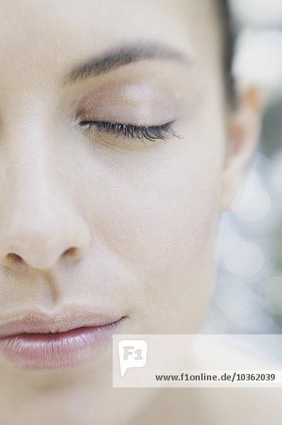 Close up of woman with eye closed