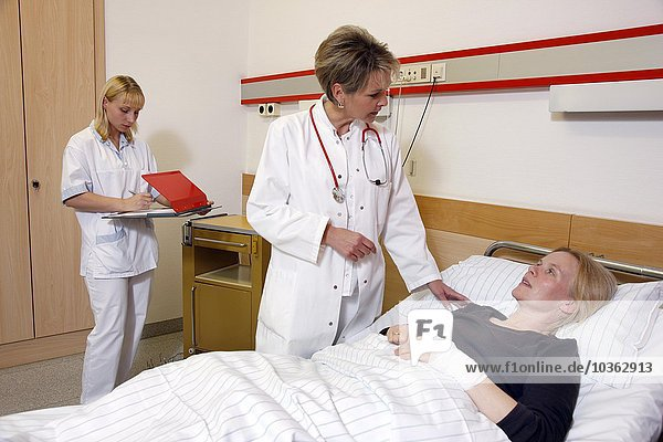 Female doctor in a hospital talks to a patient