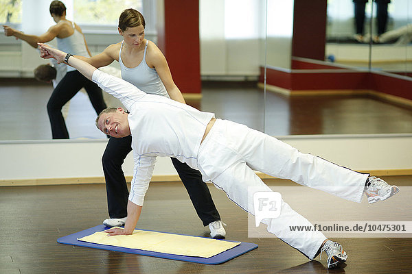 personal trainer with his patient