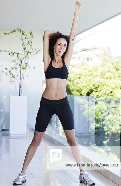 MODEL RELEASED. Woman stretching. Woman stretching