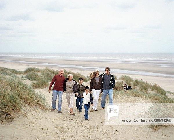 Family walking along a beach