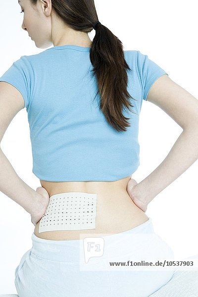 woman with warming patch