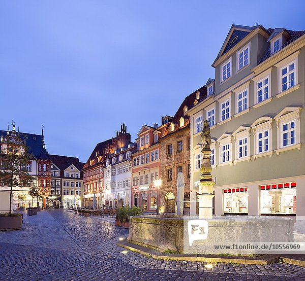 Historic residential and commercial buildings on the market at dusk  Spengler Fountain  District Coburg  Upper Franconia  Bavaria  Germany  Europe
