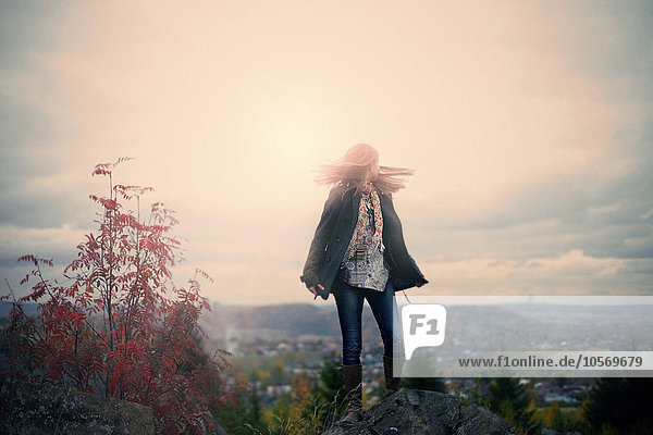 Caucasian girl standing on hilltop