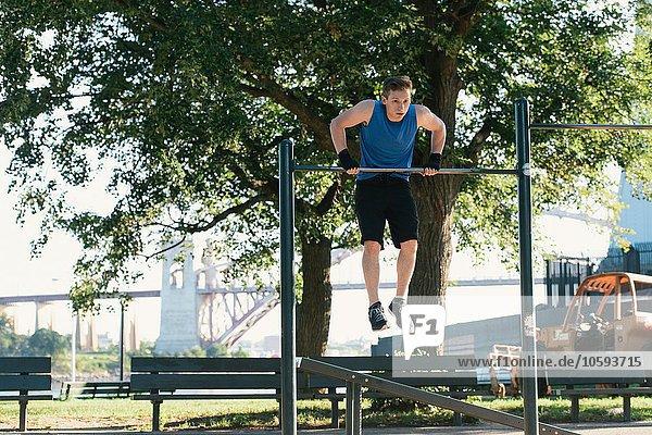 Young man exercising  using bar