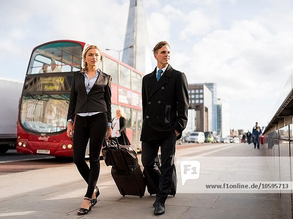 Businessman and businesswoman on business trip  London  UK