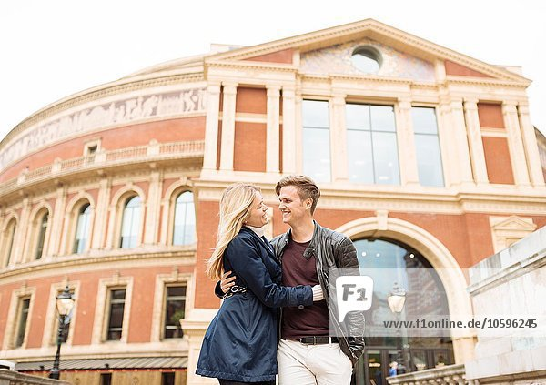 Romantic young couple strolling outside Albert Hall  London  England  UK
