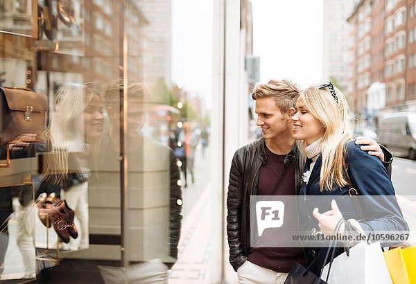 Young couple window shopping  London  England  UK