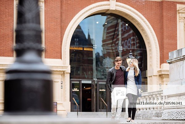 Young couple strolling outside Albert Hall  London  England  UK