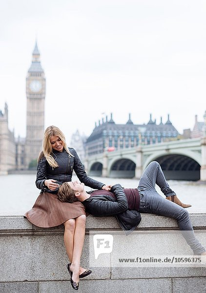 Romantic young couple on wall in front of Big Ben  London  England  UK